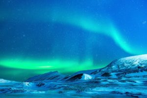 aurora borealis over an icy landscape