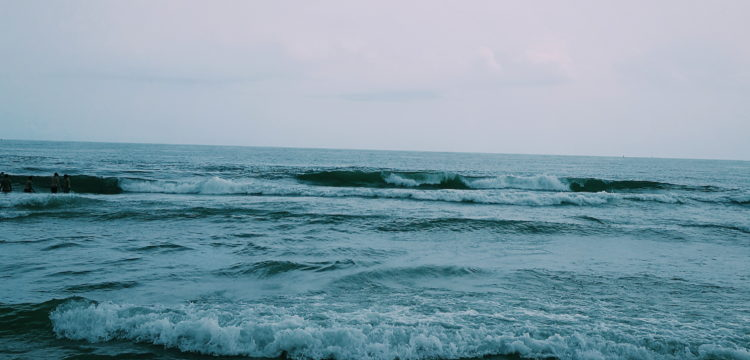 Ocean City, Maryland, a picture of a blue shoreline with waves incoming