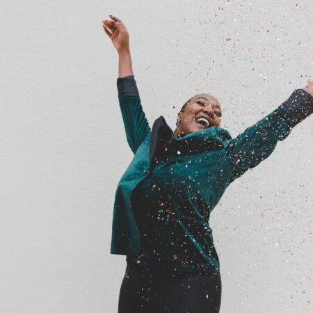 woman throwing confetti into the air